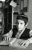 """ילד לומד בישיבה בכפר חב""""ד."""