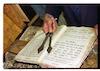 Usage of Kulmus (Torah pointer) in the Gilah Synagogue in Kuba – הספרייה הלאומית