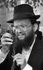 An orthodox Jew at 100 Shearim check one of the 4 Pieces used traditionally during prayers on Succot holiday – הספרייה הלאומית