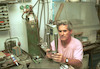 Artist Arie Ophir, working in his studio on silver candelabra – הספרייה הלאומית