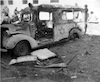 אמבולנס שרוף ליד בנין הדואר בירושלים 2-2-1948 – הספרייה הלאומית