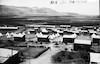 """רפרודוקציה לתצלום משנות העשרים, בית השיטה 39 צריפים בתים, אוהלים מהמפעל """"הסורגים"""" – הספרייה הלאומית"""