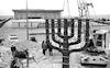 A huge bronze candelabre, Menora, was placed opposite the new Knesset building – הספרייה הלאומית